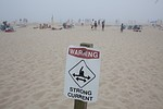 CHATHAM, MA - AUGUST 22: A sign warns beachgoe...