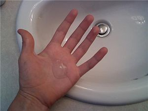 Liquid antibacterial soap on a person's hand.
