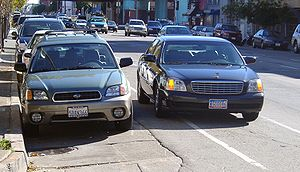 Double parked car with diplomatic tags in San ...